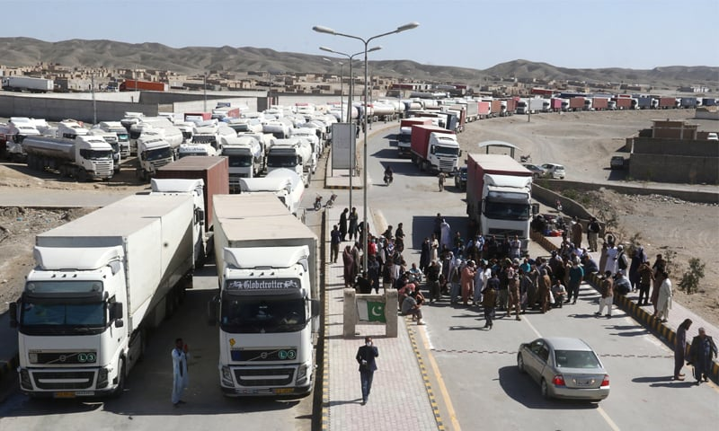 Trucks wait to cross into Iran, after Pakistan sealed its border with Iran as a preventive measure following the coronavirus outbreak, at the border post in Taftan, Pakistan.—Reuters