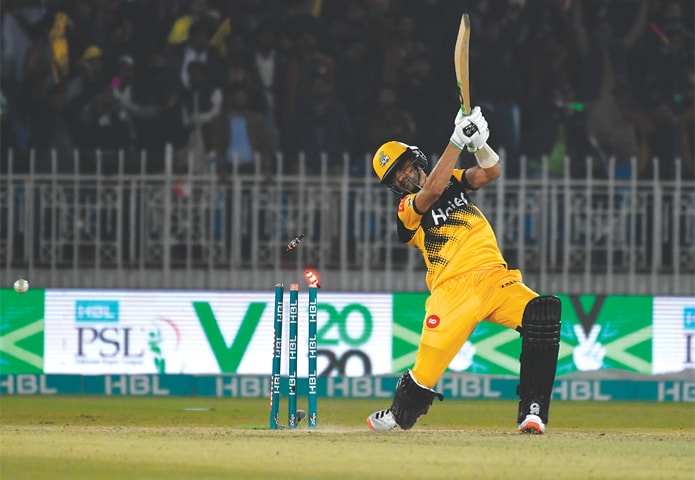 RAWALPINDI: Peshawar Zalmi batsman Shoaib Malik is cleaned up by Quetta Gladiators pacer Mohammad Hasnain during their Pakistan Super League match at the Pindi Cricket Stadium on Thursday.—Tanveer Shahzad/White Star