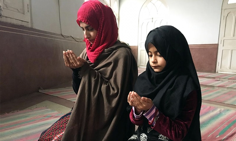 A woman and her daughter pray at Peshawar's Sunehri Masjid on Friday. — Photo by author