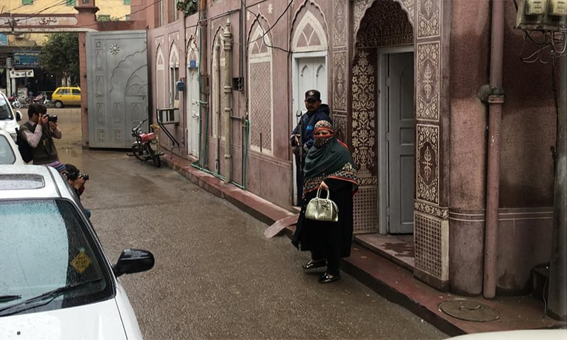A woman steps out of Sunehri Masjid. — Photo by author