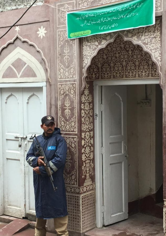A police personnel stands outside the mosque. — Photo by author