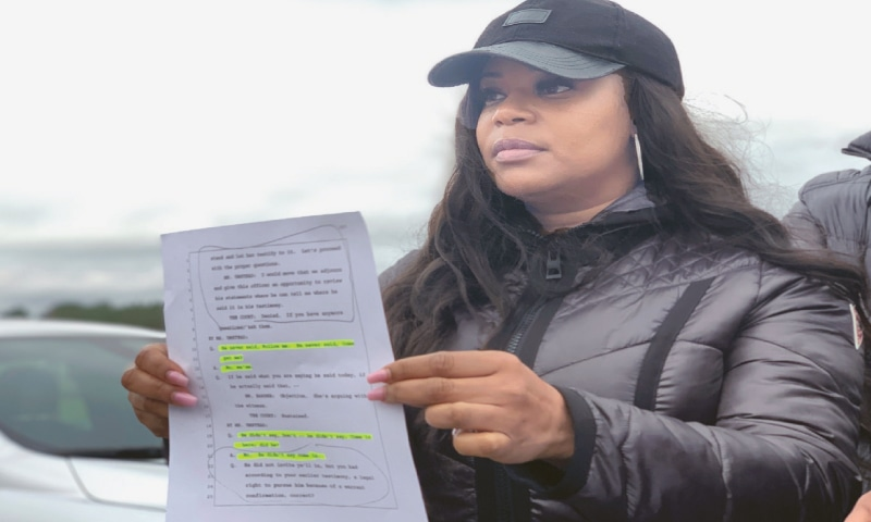 Pamela Woods, sister of Nathaniel Woods, speak to reporters outside Holman Correctional Facility ahead of his scheduled execution on Thursday. She holds a page from the trial transcript that, she claims, shows that her brother was surrendering when three police officers were shot by another man in 2004.—AP