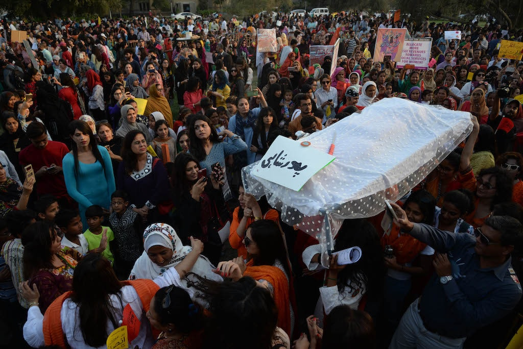 Women carry patriarchy's *'janaza'* (funeral of patriarchy) at a previous Aurat March in Karachi | Shakil Adil, White Star