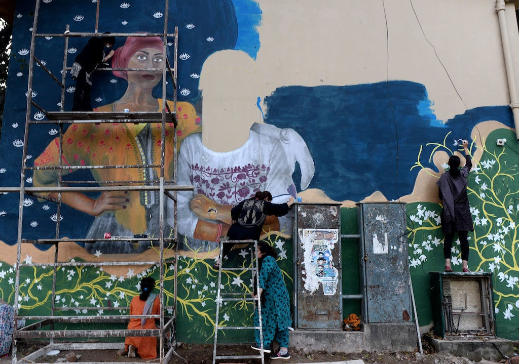 Volunteers paint a mural that was later vandalised ahead of the Aurat March in Islamabad | Mohammad Asim, White Star