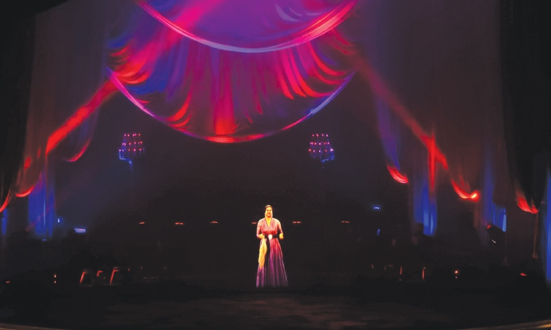 A hologram of legendary Arab singer Umm Kulthum is projected on stage at Cairo Opera House.—AFP