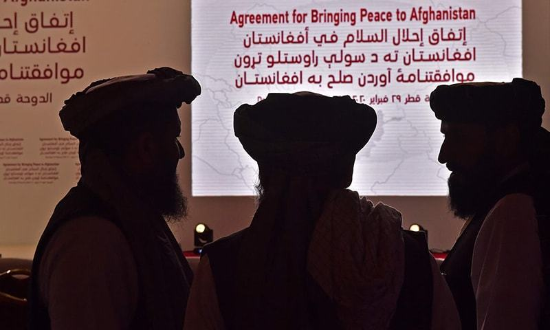 Members of the Taliban delegation gather ahead of the signing ceremony with the United States in the Qatari capital Doha, on February 29. — AFP/File