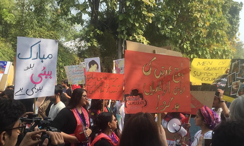 Marchers gather in Lahore for the Aurat March on Sunday. — Photo courtesy Imran Gabol