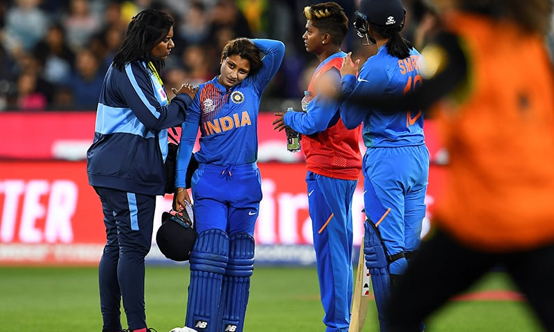India's batswoman Taniya Bhatia walks off the field as retired for being hurt during the Twenty20 women's World Cup cricket final match between Australia and India in Melbourne on Sunday. — AFP