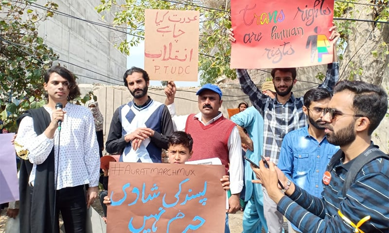 Marchers hold placards outside Multan Press club. — Photo courtesy Imran Gabol