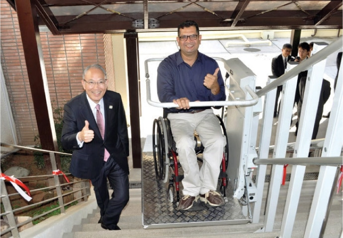 Japanese Ambassador Matsuda Kuninori and Milestone Society for the Special Persons President Mohammad Shafiqur Rehman inaugurate the wheelchair lift.
