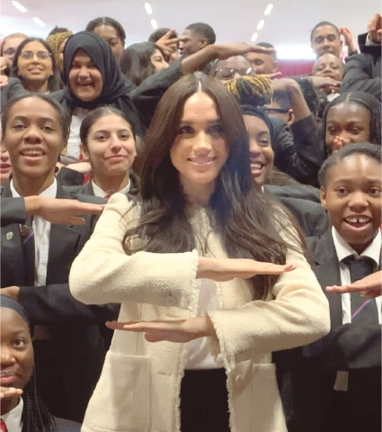 Meghan Markle with schoolchildren during a visit to a school in Essex.—Reuters