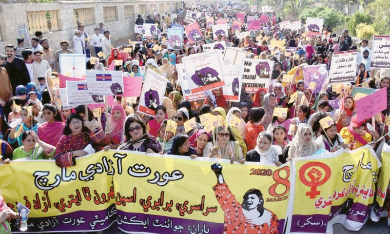 PARTICIPANTS in the march walk to the Sukkur Press Club.—APP