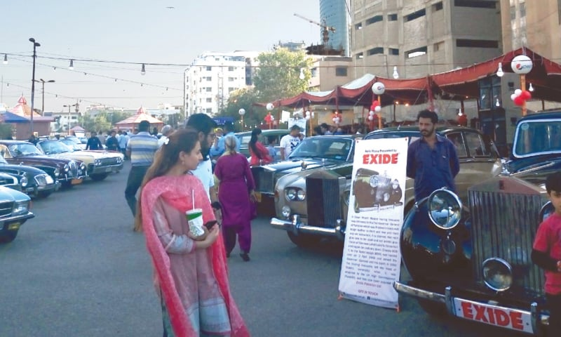 Lovers of vintage and classic cars at the 17th Annual Vintage and Classic Car Show on Sunday.—Photo by writer