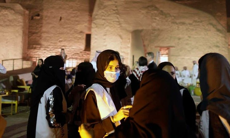 A Saudi tour guide wears a mask, due to the coronavirus, in front of the historical Salwa Palace, in Diriyah, outside Riyadh, Saudi Arabia. — AP/File