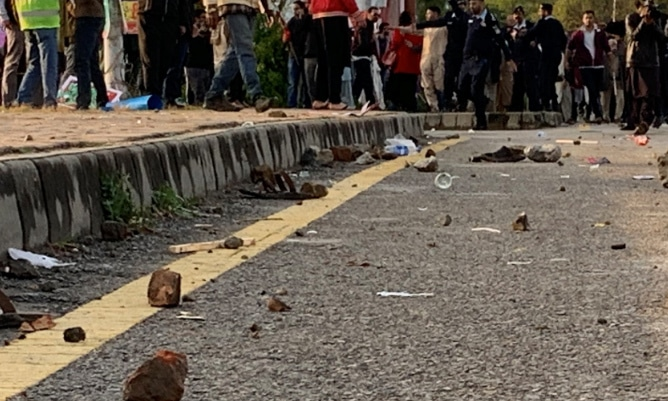 Stones pelted at Aurat March participants. — Photo from Twitter