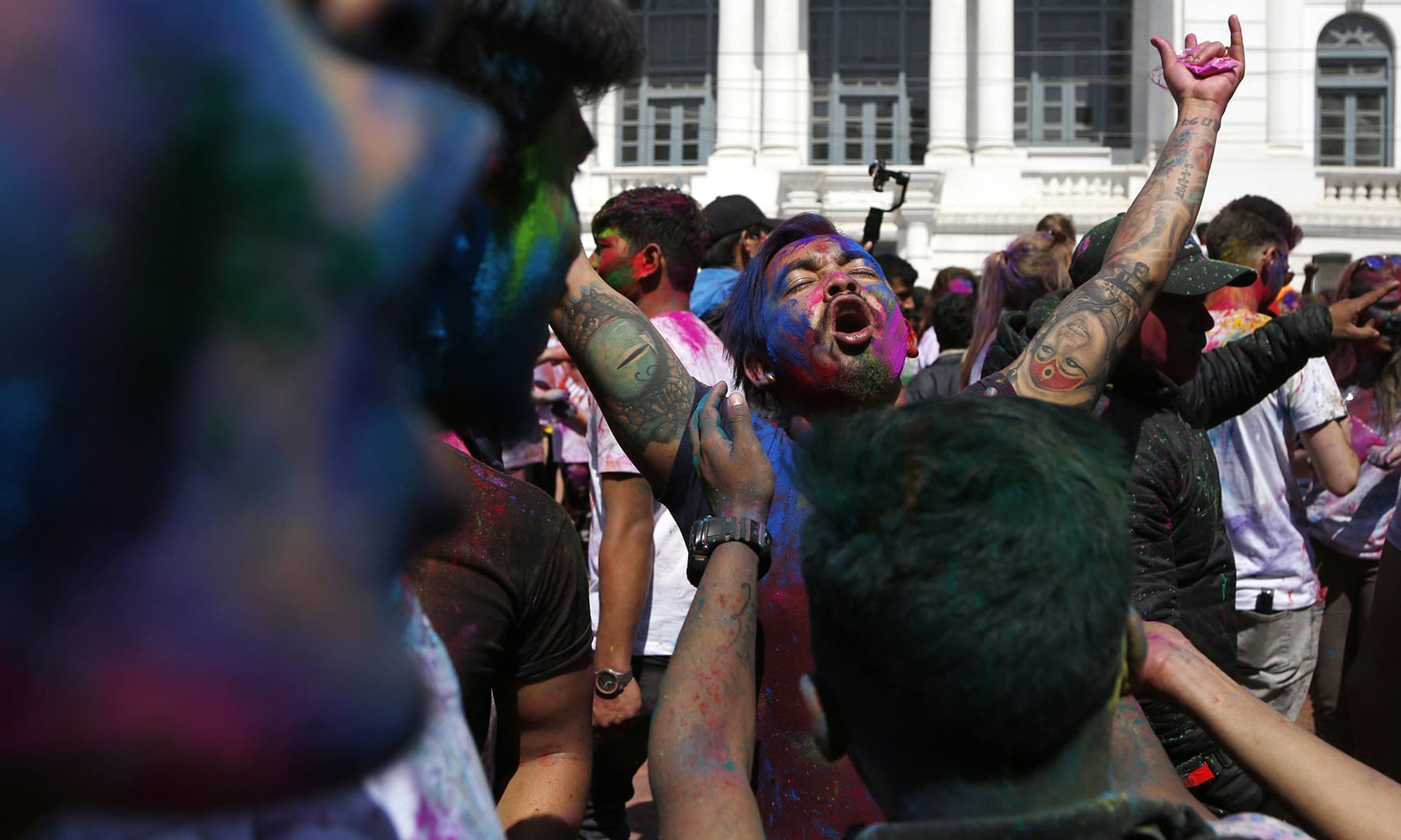 Nepalese people throw colours on to each other as they play Holi in Kathmandu, Nepal, Monday, March 9. — AP