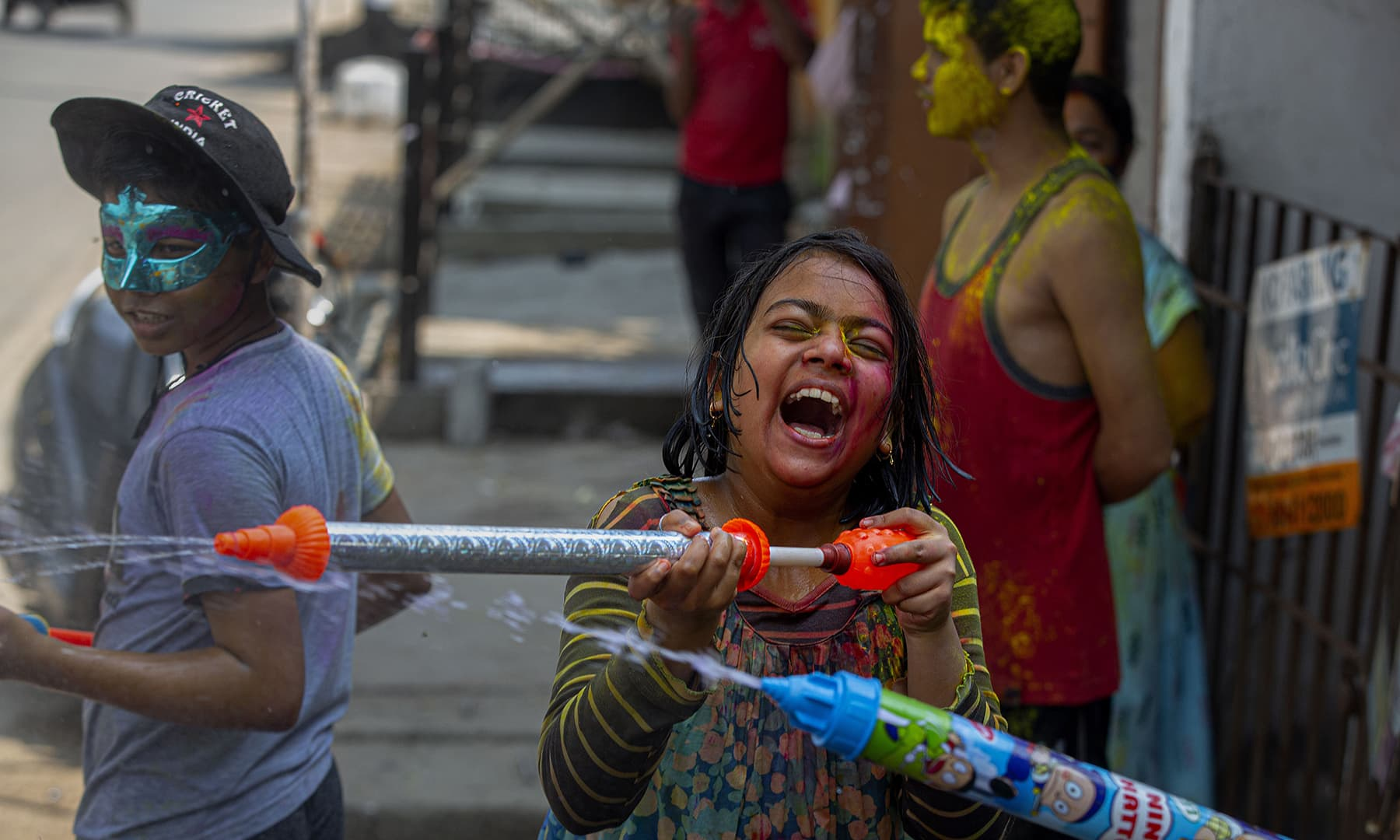 Indian children spray coloured water as they celebrate Holi festival in Gauhati, India. — AP