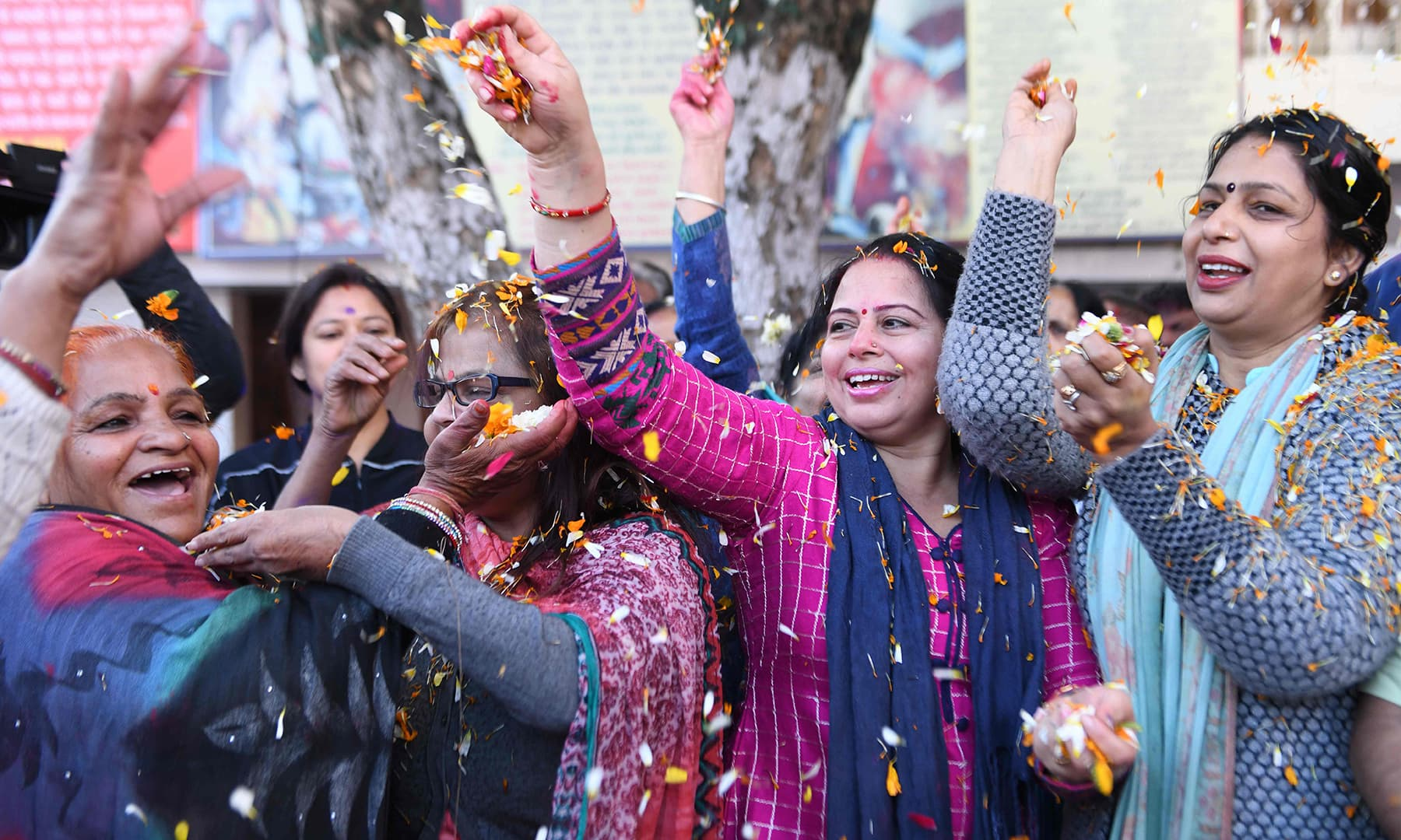 Hindu devotees celebrate Holi with flower petals at a temple in Amritsar. — AFP