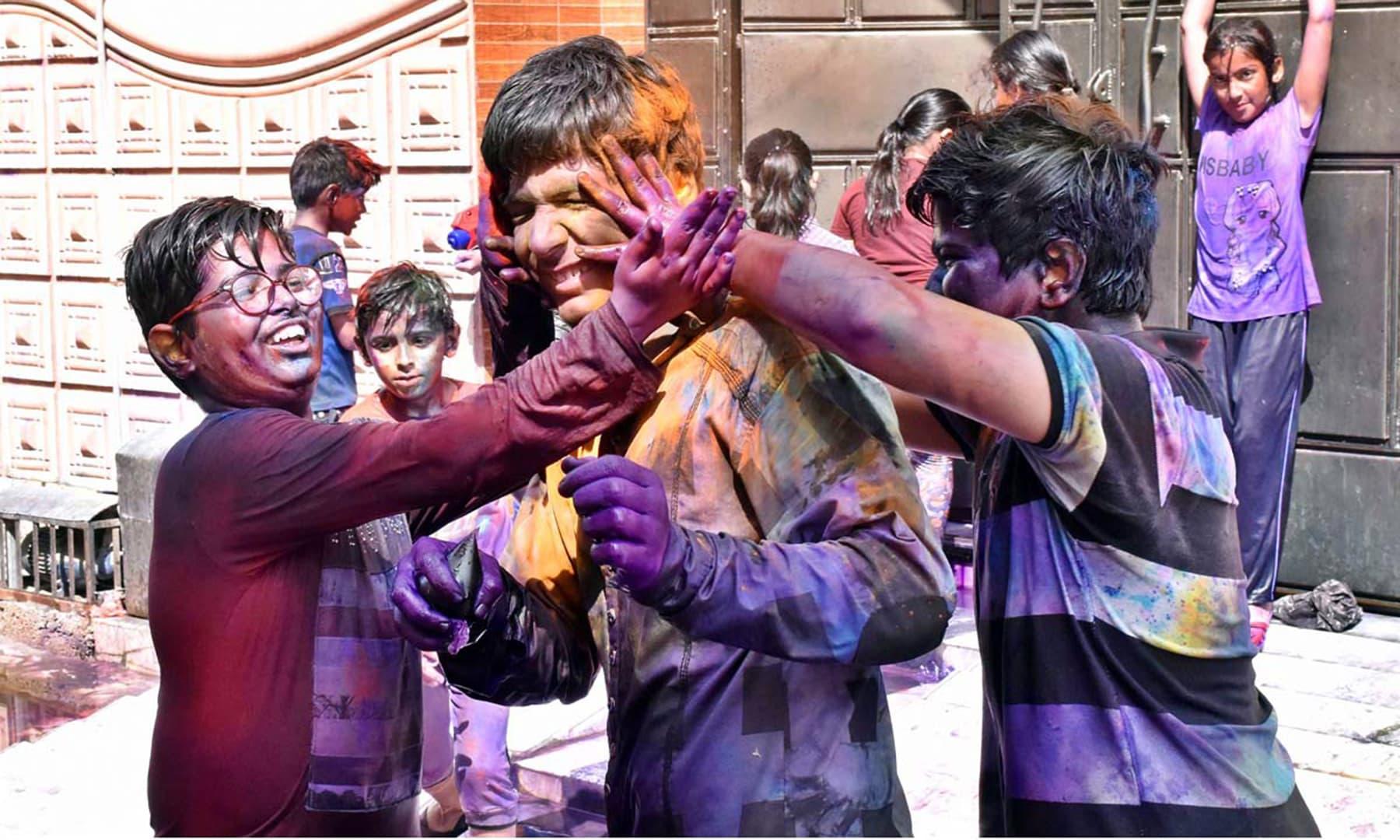 Children celebrate Holi with colours in Larkana, Sindh, Pakistan. — APP