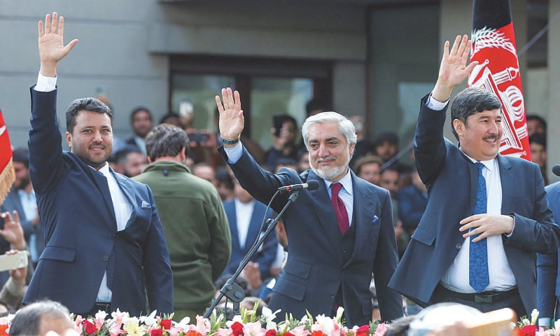 Former CEO Abdullah Abdullah, accompanied by his first Vice President Babur Farahmand (left) and his second VP Asadullah Sahadati, gestures to supporters after his swearing-in ceremony as Afghanistan's president. —  Reuters