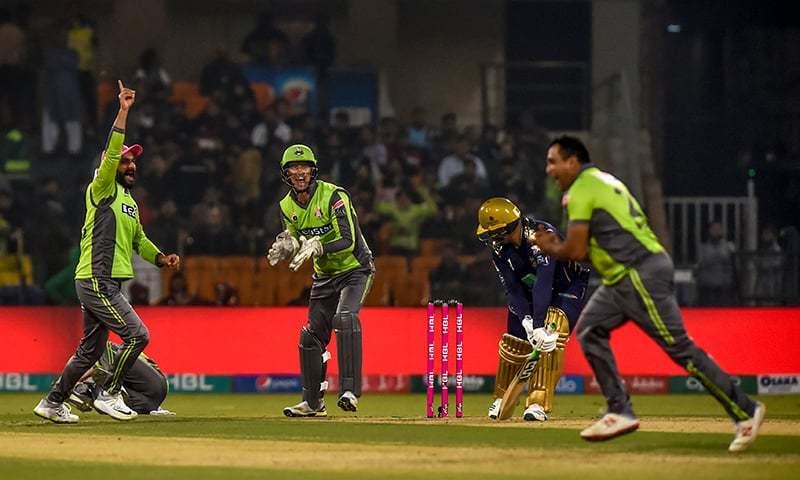 Lahore Qalandars' Samit Patel (R) celebrates the dismissal of Quetta Gladiators' Azam Khan (2R) during thePakistan Super League (PSL) T20 cricket match at the Gaddafi Cricket Stadium in Lahore on Saturday. — AFP/File