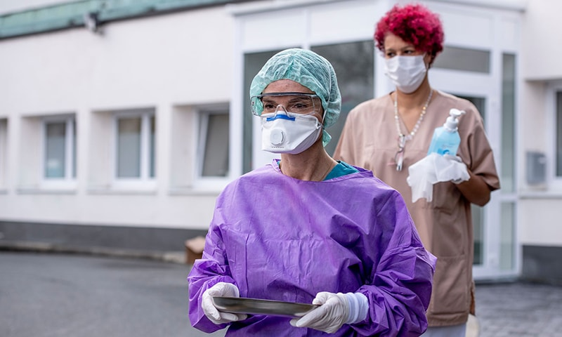Roxana Sauer, Medical Director of the Medical Care Centre (MVZ) gets prepared to take samples for COVID-19 coronavirus tests on a fictional patient at a drive-through testing centre on March 9, 2020 in Gross-Gerau. — AFP