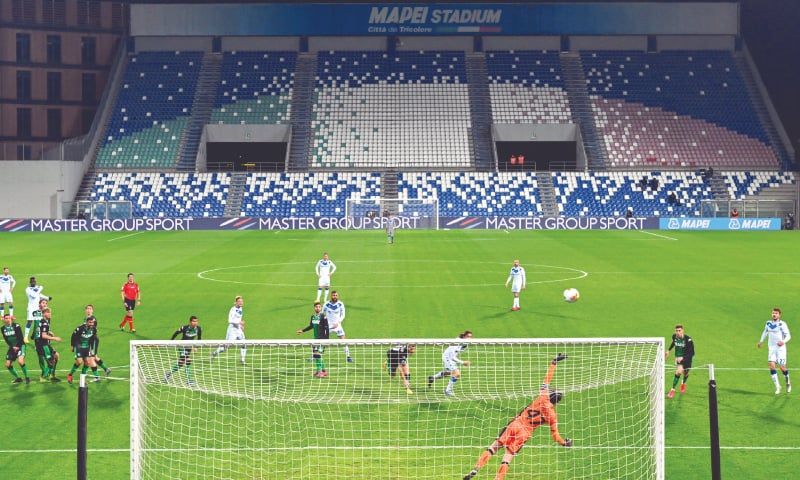A VIEW of the empty stands at the Mapei stadium as the Serie A match between Sassuolo and Brescia is being played behind closed doors, in Reggio Emilia.—AP