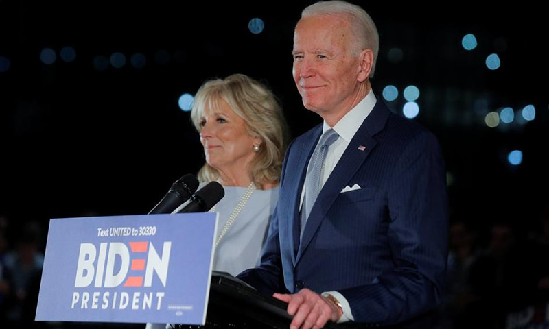 Democratic US presidential candidate and former vice president Joe Biden speaks with his wife Jill at his side during a primary night speech at the National Constitution Center in Pennsylvania, US on March 10. — Reuters