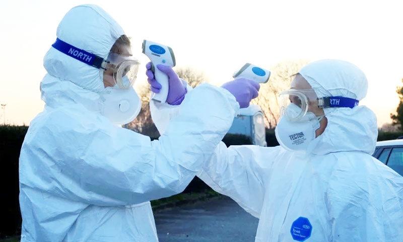 عالمی وبا کا مقصد وائرس کا مل کر مقابلہ کرنا ہے—فوٹو: اے ایف پی
