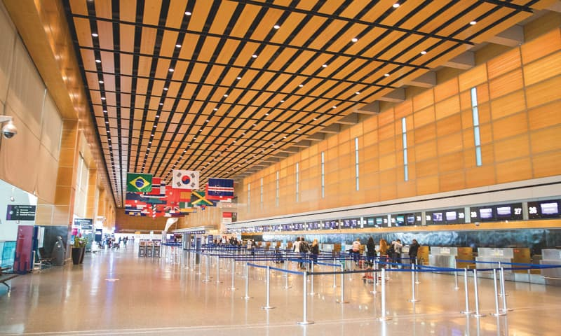 BOSTON: The departures area is nearly empty in the international terminal of Logan Airport on Friday. The Trump administration has banned all non-US citizens from flying from continental Europe to the US in an effort to slow the ongoing spread of the coronavirus.—AFP