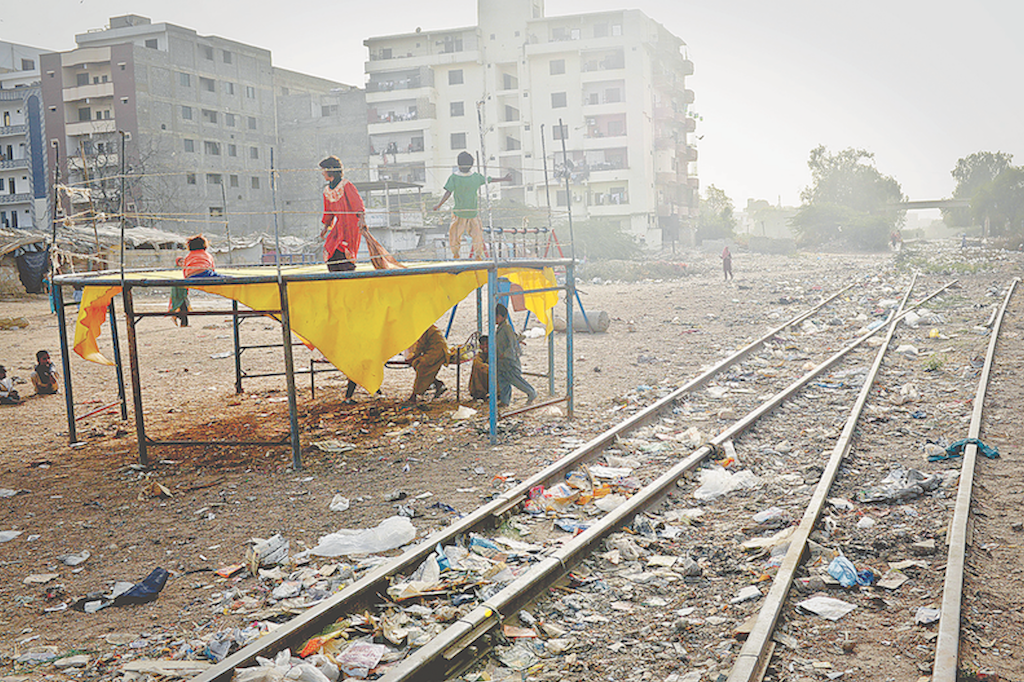 Children play on a trampoline set up close to abandoned tracks near a railway station in Gulshan-i-Iqbal | Fahim Siddiqi/White Star
