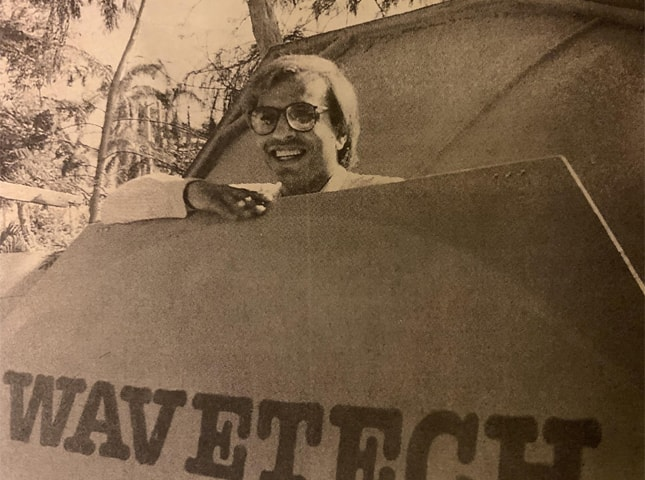 Dr Kamal with a Wavetech satellite dish — photo from Herald, April 1994