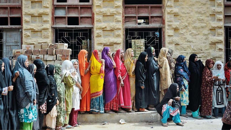 Women line up to receive money from the Benazir Income Support Programme in Karachi | Reuters