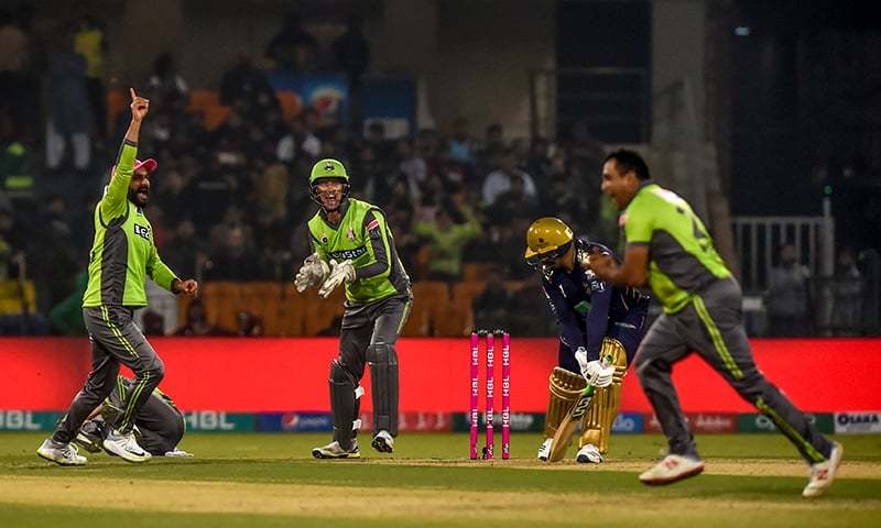 Lahore Qalandars' Samit Patel (R) celebrates the dismissal of Quetta Gladiators' Azam Khan (2R) during the Pakistan Super League (PSL) T20 cricket match between Lahore Qalandars and Quetta Gladiators at the Gaddafi Cricket Stadium in Rawalpindi on March 7.  — AFP/File