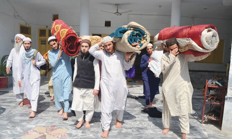 PESHAWAR: Students leave their madressah in the Maskinabad Nauthia area after it was closed over fear of coronavirus outbreak.—Shahbaz Butt / White Star