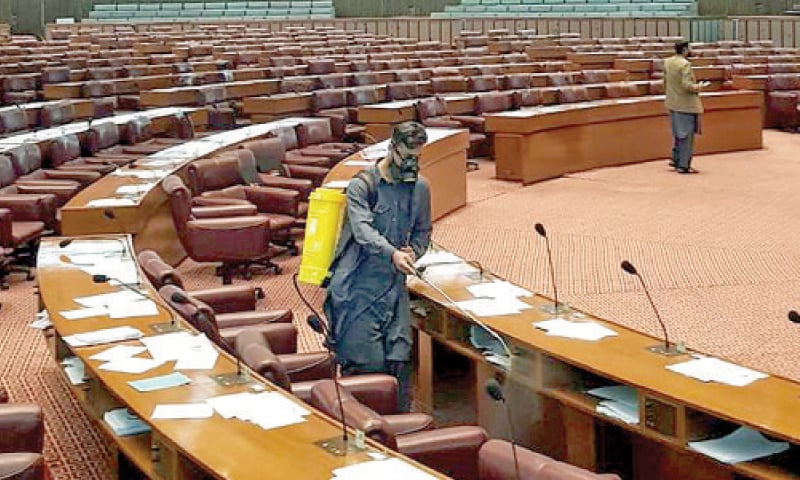 Fumigation being carried out at the Parliament House in Islamabad on Sunday.