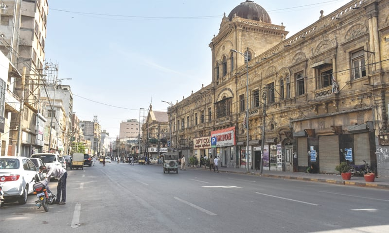 The usually bustling Zaibunnisa Street in Saddar wears a deserted look on Monday afternoon as people opt to stay away from commercial centres, other than superstores. —Fahim Siddiqi/White Star