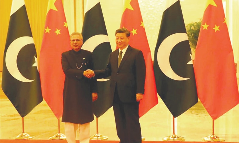 BEIJING: President Dr Arif Alvi shakes hands with Chinese President Xi Jinping prior to a meeting on Tuesday.—PPI