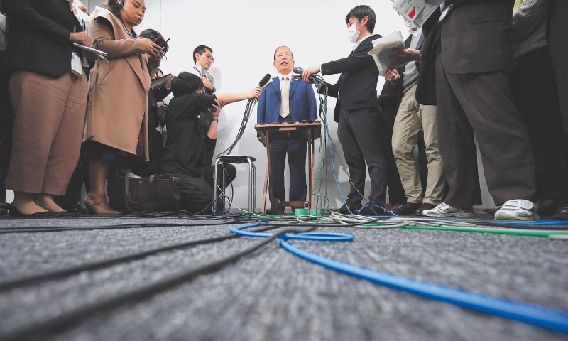 TOKYO: Toshiro Muto, CEO of the Tokyo 2020 Organising Committee, is surrounded by journalists during a news conference on Tuesday.—AP