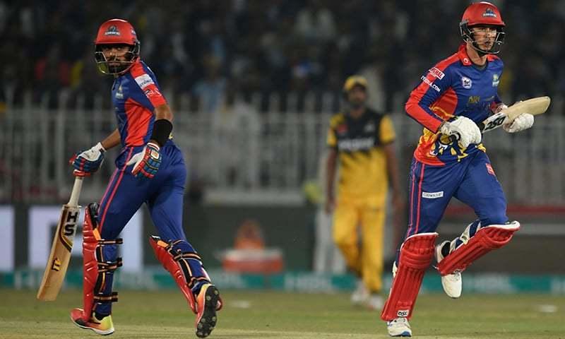 Karachi Kings' Alex Hales (R) and Babar Azam take a run during the Pakistan Super League (PSL) T20 cricket match between Peshawar Zalmi and Karachi Kings at the Rawalpindi Cricket Stadium in Rawalpindi on March 2, 2020. —AFP