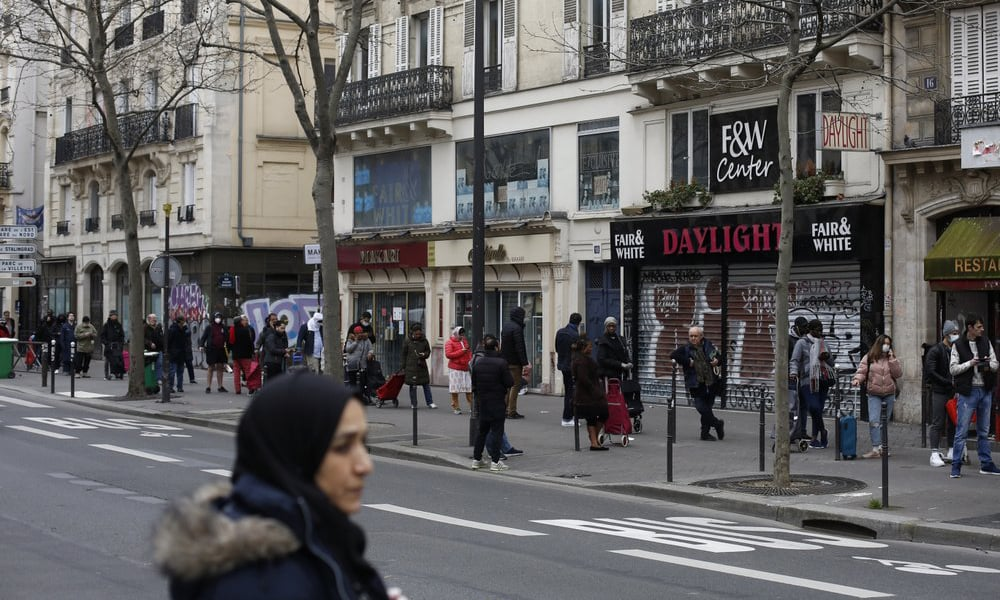 People line up at a supermarket, in Paris on March 17, 2020.— AP