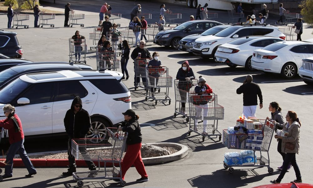 A line of people waiting to buy supplies amid coronavirus fears snakes through a parking lot at a Costco on March 14, 2020, in Las Vegas. — AP