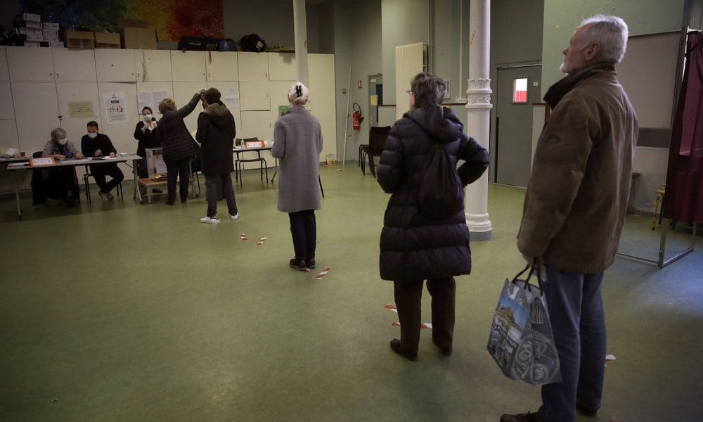 People wait in line to vote for local elections on March 15, 2020, in Paris. — AP