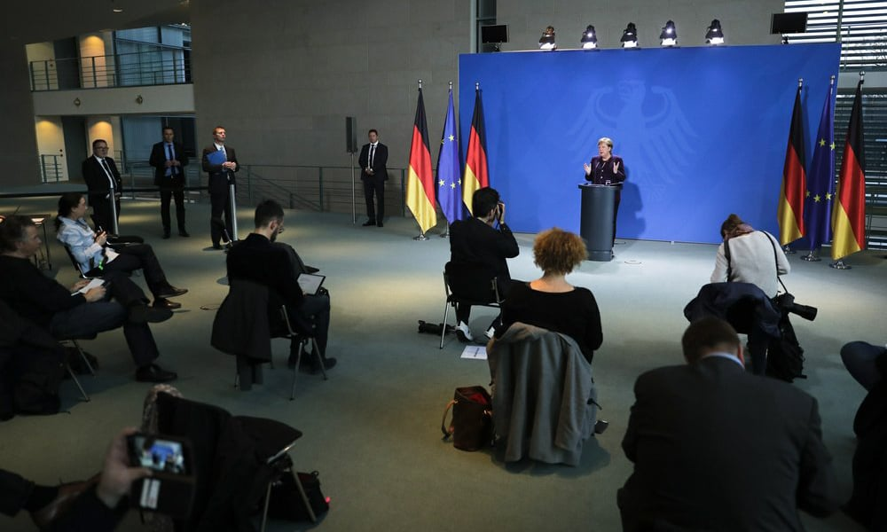 German Chancellor Angela Merkel speaks during a news conference about the coronavirus, where journalists sit spread out, at the chancellery in Berlin, Germany on March 16, 2020. — AP