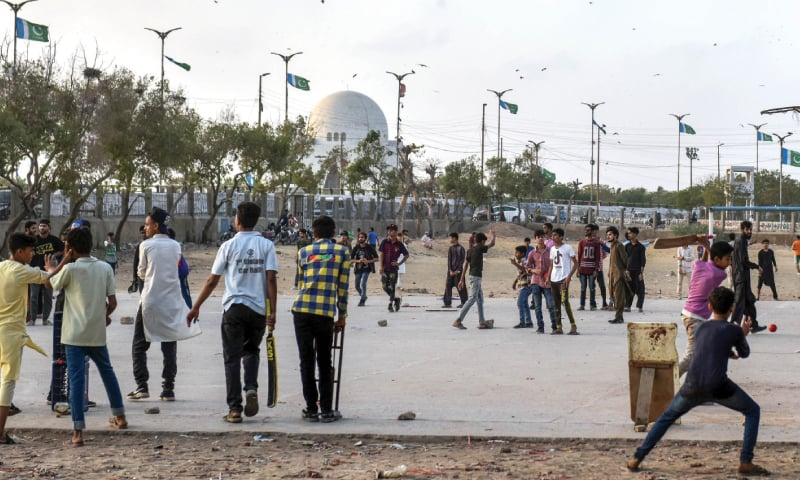 Despite frequent pleas from the authorities to maintain social distancing, kids play in close proximity near the Quaid's mazar on Friday.—Fahim Siddiqi/White Star