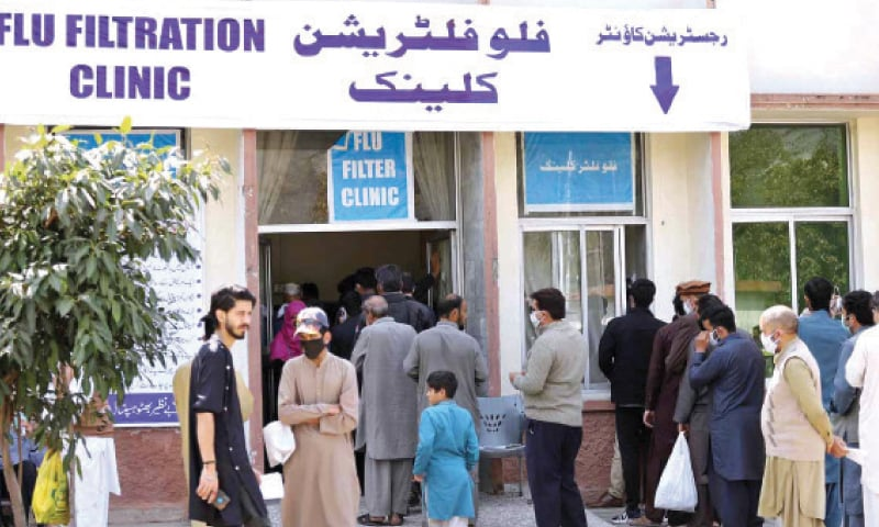 People queue outside the registration counter of the flu filtration clinic at Benazir Bhutto Hospital in Rawalpindi on Friday. — APP