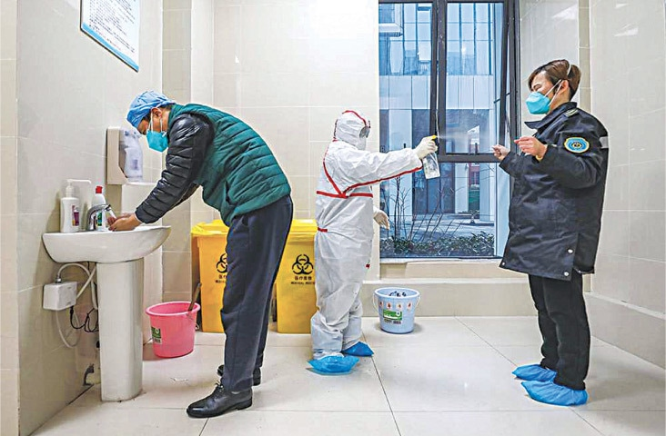 A medical staff member is being disinfected in a hospital in Wuhan, January 26 | AFP