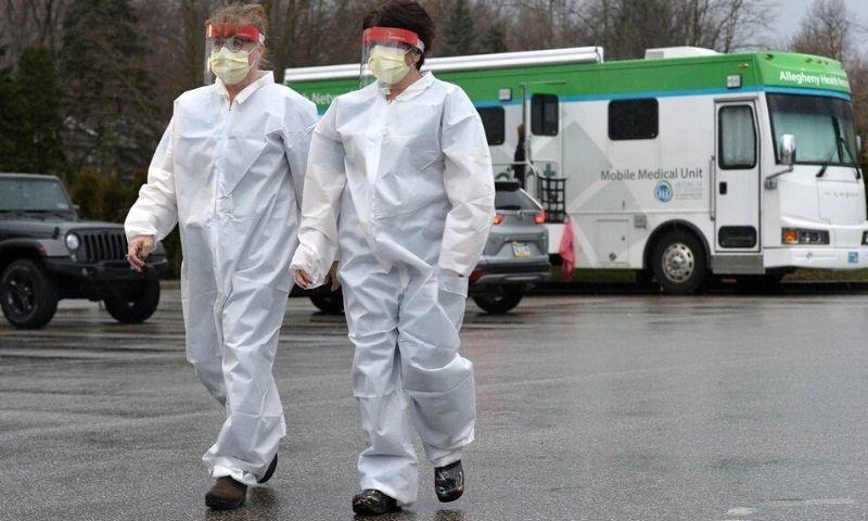 US locking down 70 million people as virus strains Europe