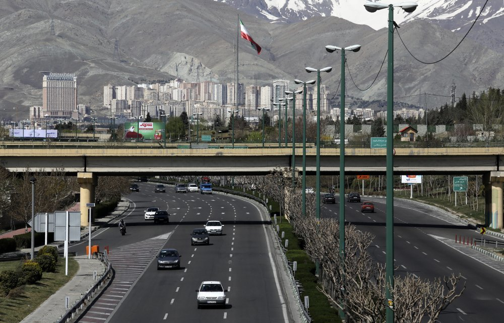 "Cars drive in a highway in northern Tehran, Iran, on Friday, March 20, on the first day of Iranian New Year, called Nowruz, or ""New Day"" in Farsi, the Persian holiday marking the the spring equinox. — AP"