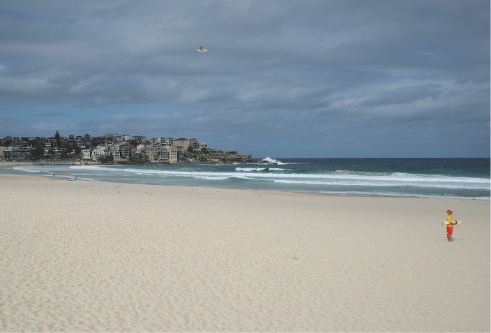 Sydney: Surf rescue personnel enforce a closure of Bondi Beach on Saturday after thousands of people flocked there in recent days, defying social distancing orders to prevent the spread of the coronavirus disease.—Reuters